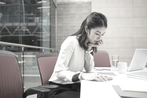 Businesswoman reviewing paperwork in conference room