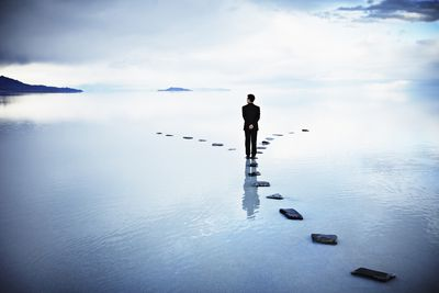 man standing in a sea of choices trying to pick a career path