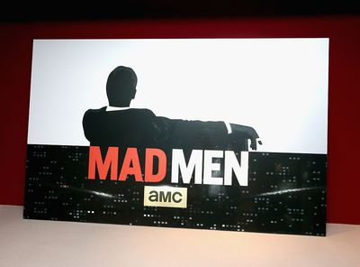 Mad Men on AMC logo on a wall.