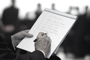 Businessman Writing List