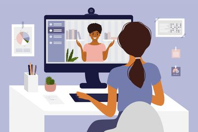 Young woman making video call through computer