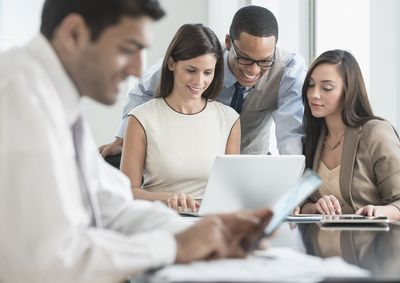 Business people working together in an office to review the answers to their toughest questions.