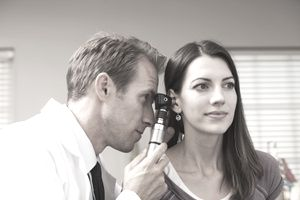 Doctor Performing Hearing Test With Otoscope