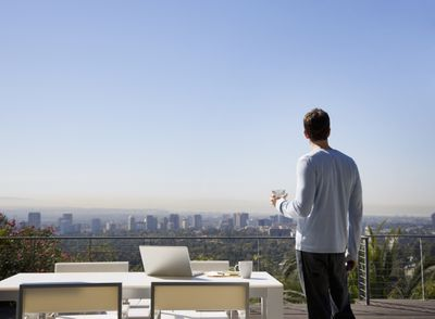 Remote worker taking in the view on a patio