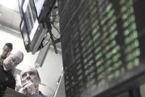 men watching stocks at the stock exchange