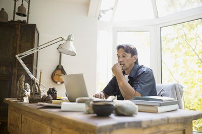A man working at a laptop at home
