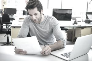 man with laptop and document