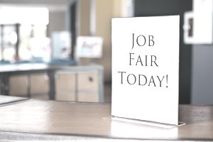 Job Fair Today sign at registration table for business event