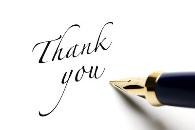 thank you written in calligraphy next to pen
