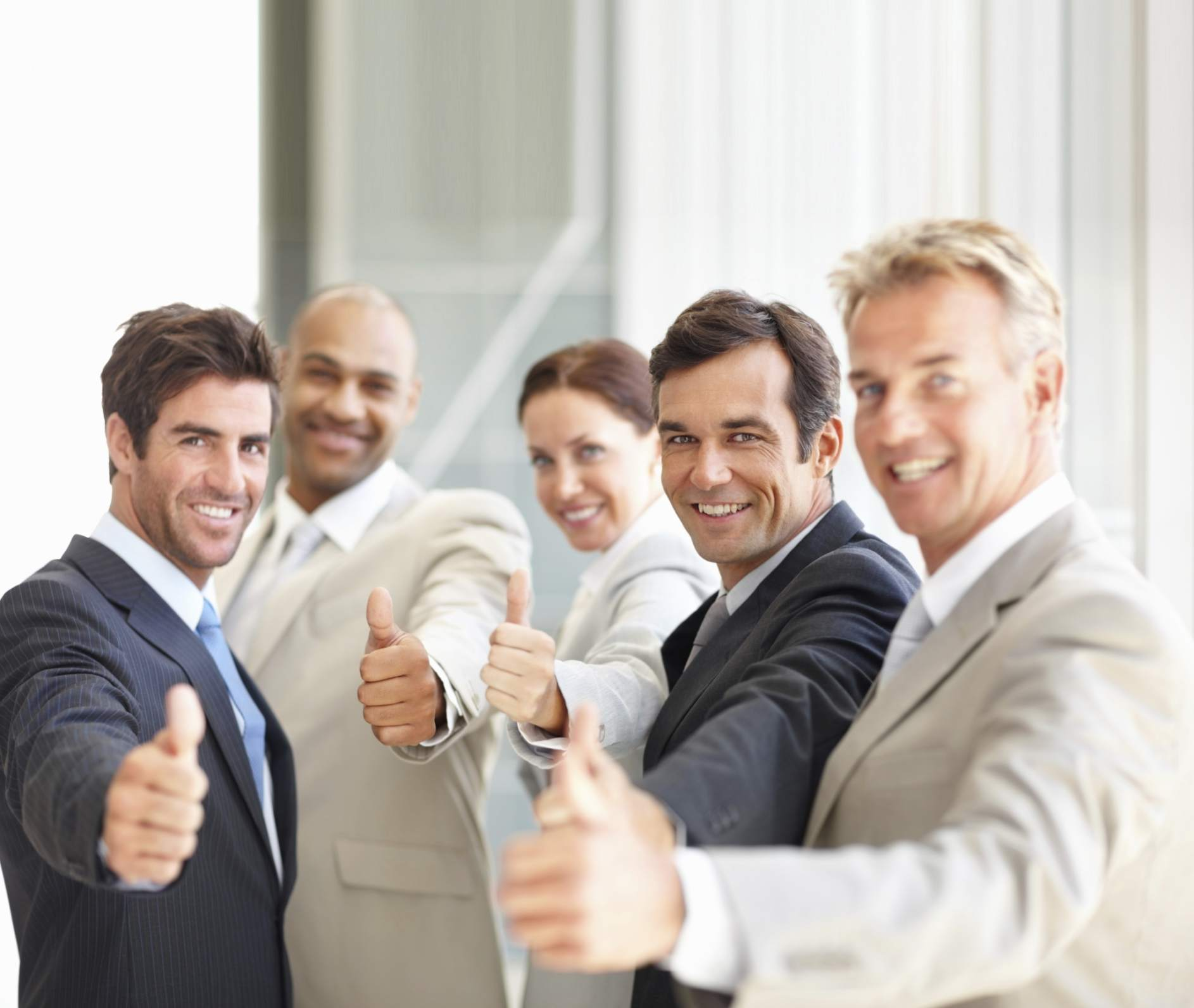 Positive coworkers giving thumbs up
