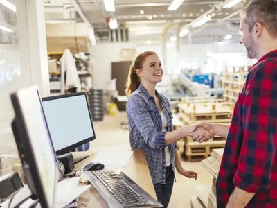 Young employee shaking hand with older man