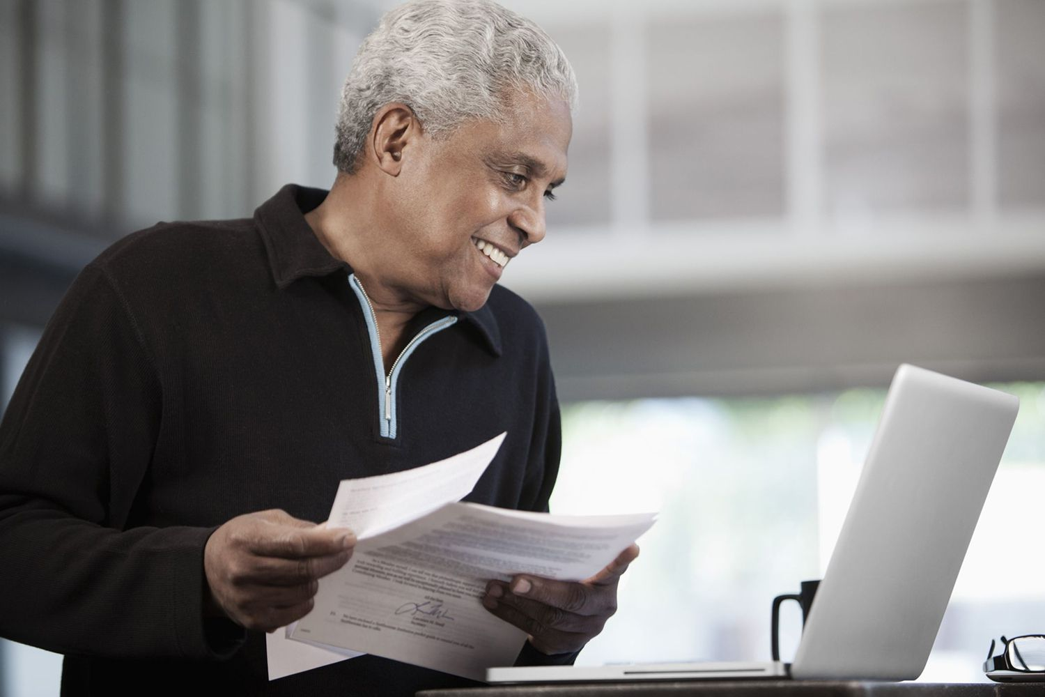 Man With Letter and Laptop