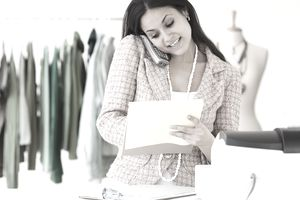 Woman working in clothing shop