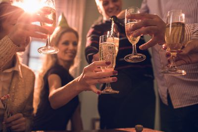 People toasting the new year with champagne should not drink too much at an office party.