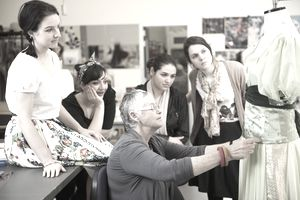 Senior lecturer teaches students dressmaking skills