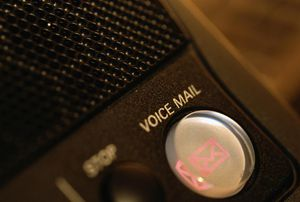 Voice mail button on telephone