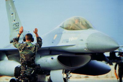 USAF SERE Specialist guiding a Military Airplane