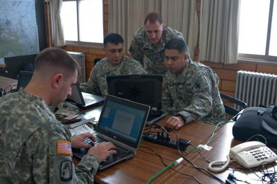 soldiers working on computers