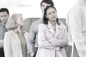 Sad woman in standing in line at unemployment office