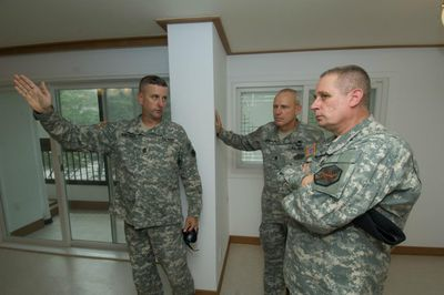 Soldiers walking through Military Family Housing