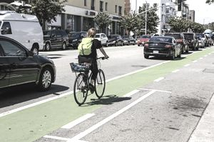 Cyclist riding in bicycle lane