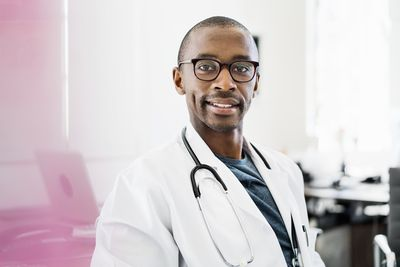 Doctor with stethoscope in hospital