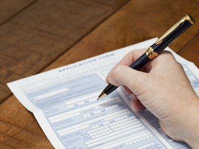 Job candidate filling out employment application