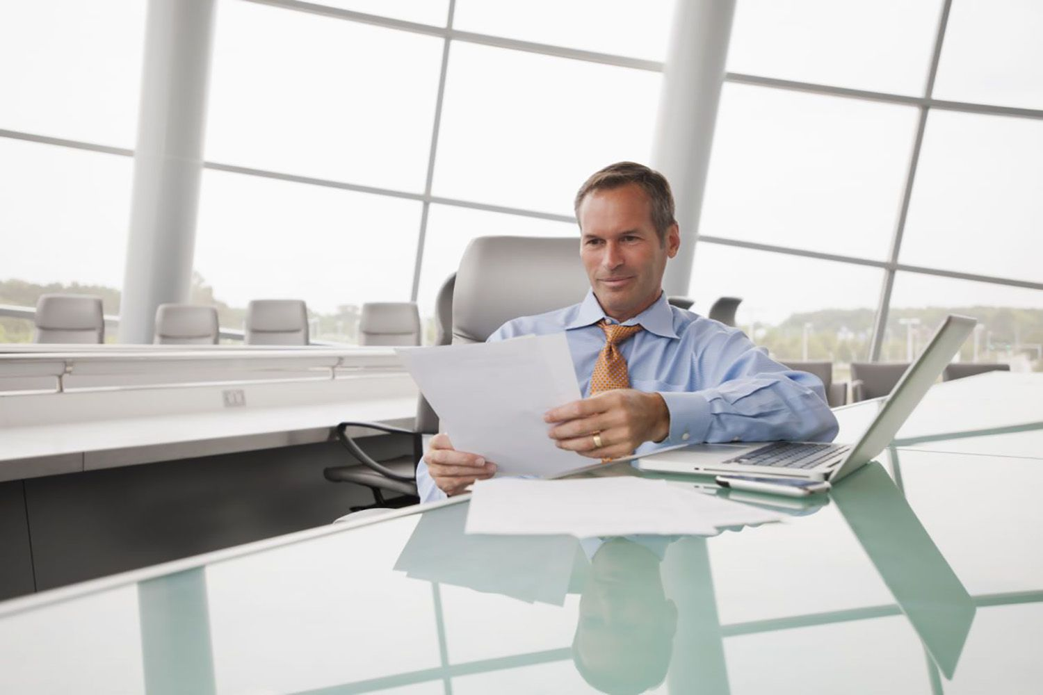 Business Man Reviewing Cover Letter
