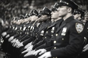 Police recruits sitting at attention during a ceremony at the police academy.