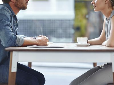 Two people in coffee shop