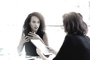 Two businesswomen having an animated discussion.