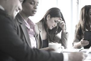 upset woman in meeting