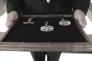 Army Combat Action Badges presented in a case