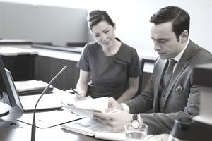 Two lawyers looking over paperwork for a case