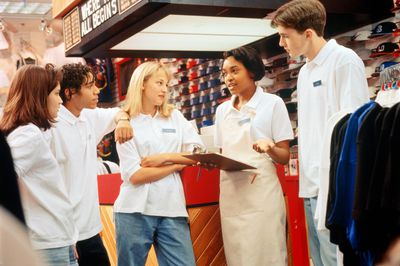 Retail sales manager holding meeting with employees