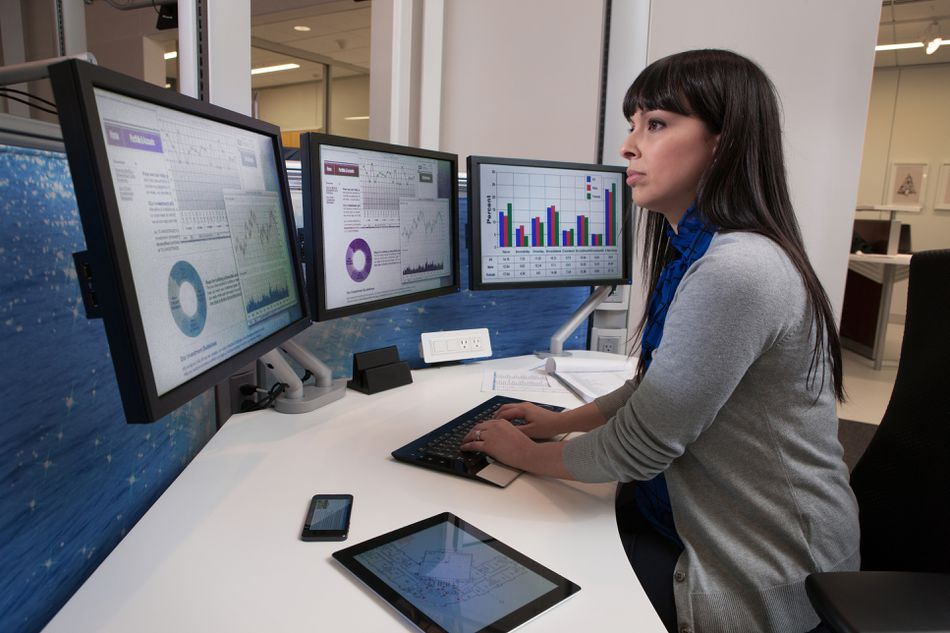 Financial analyst using computers