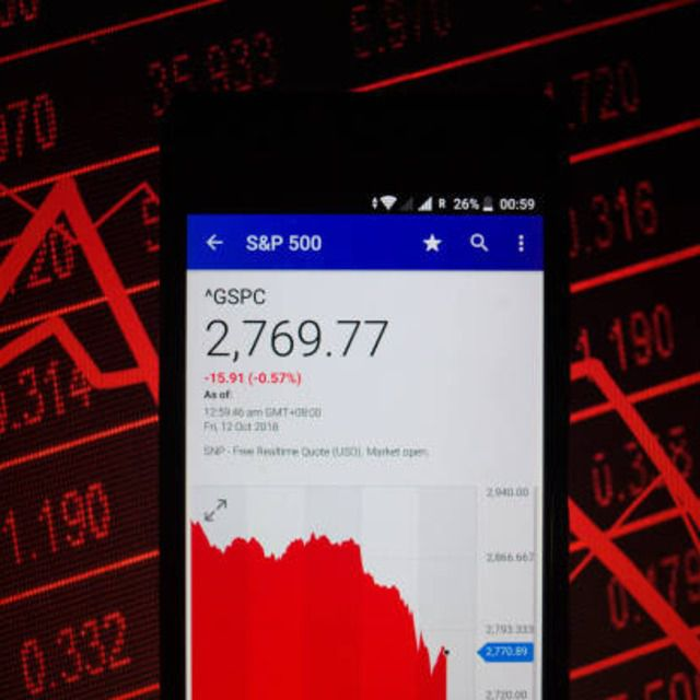A smartphone displaying the S&P 500 market value on the stock