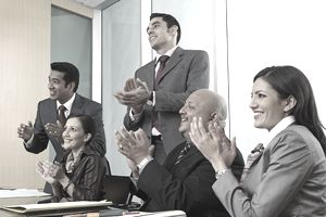 Business People Applauding at Meeting to Welcome a New Employee