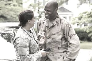 The couple of soldiers laughing and having a relationship within the Army's fraternization policy