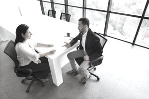 Business people talking in interview
