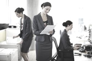 a woman depicted doing different duties at work
