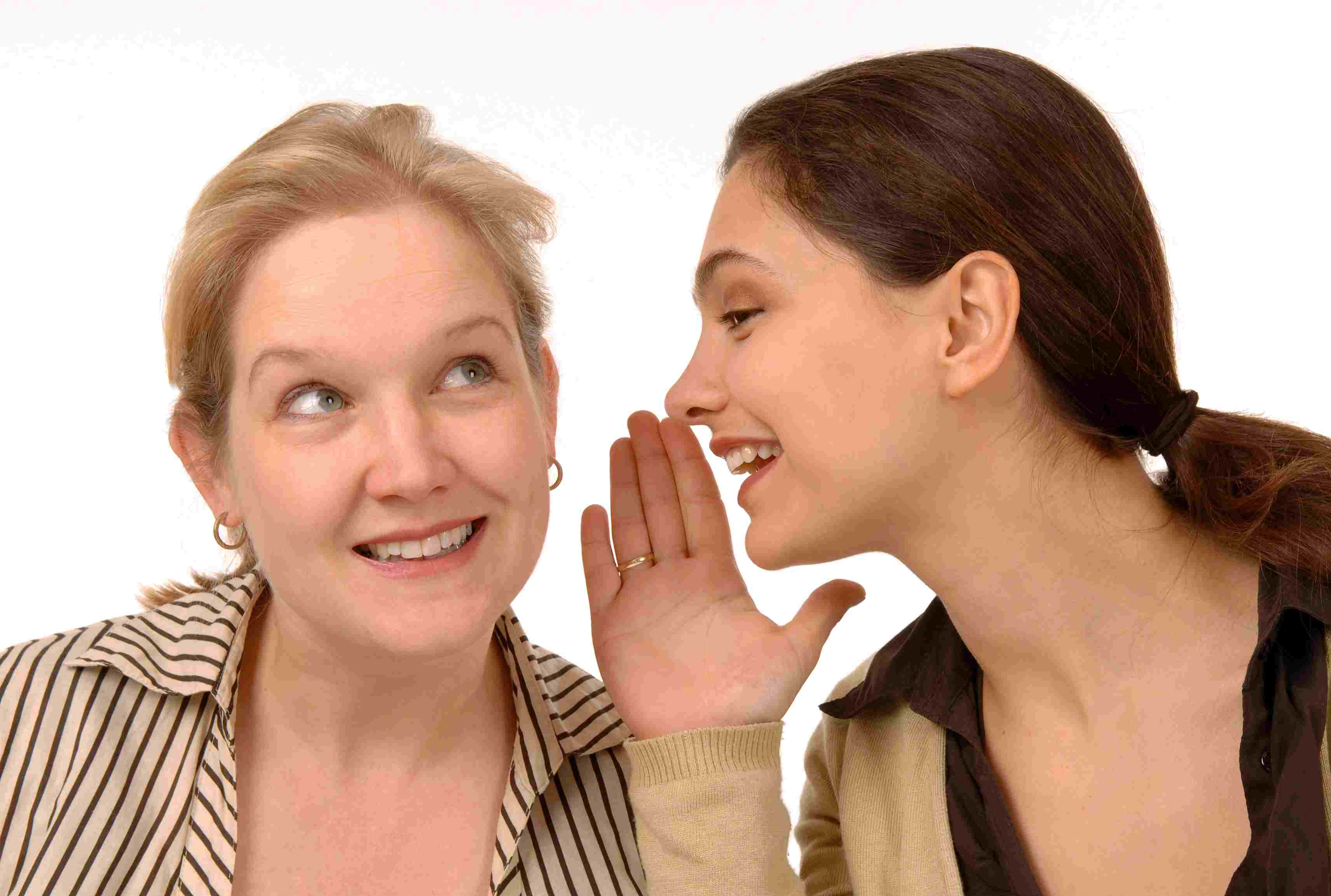 woman whispering to woman