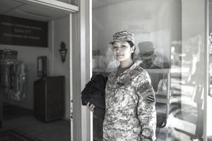 Army woman bringing laudry to dry cleaners