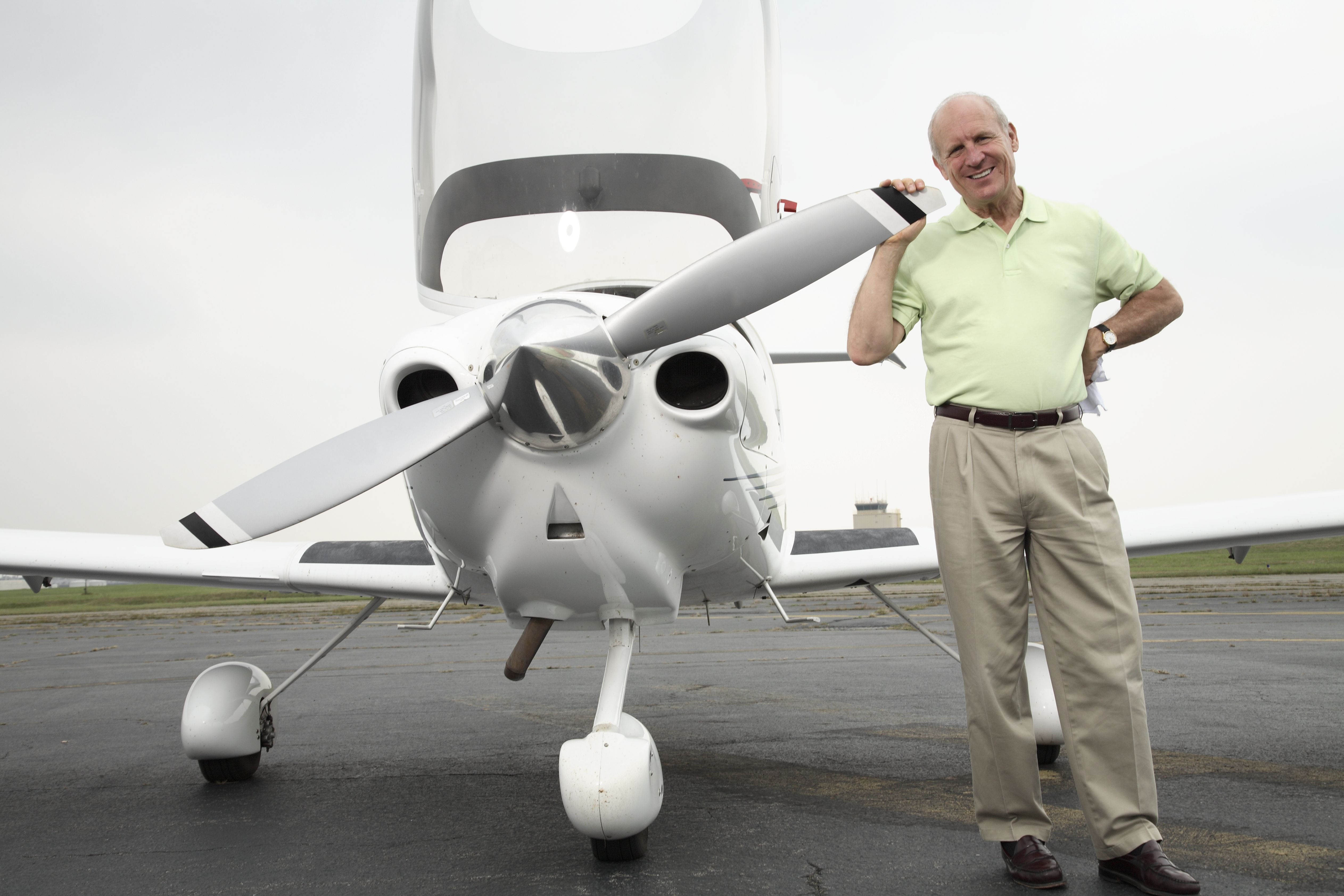 Pilot with his small airplane