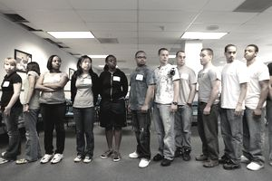 a group of young people lined up to take an air force electronic data processing test