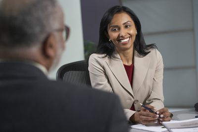 Businesswoman talking to man in a management trainee interview.