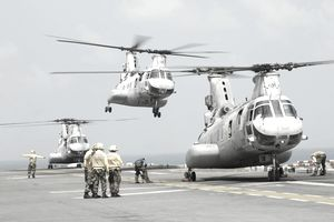 A CH-46E Sea Knight takes off from the flight deck of USS Essex.