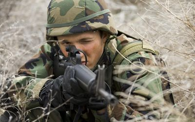 Close Up Of A Soldier Aiming His Rifle