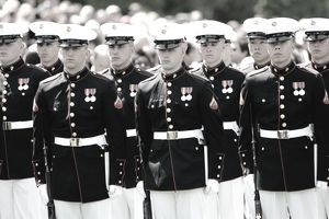 USMC drill team standing at attention as part of their marine corps requirements