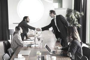 Two men shaking hands at a business meeting
